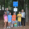 Oyster recycling bin for Sullivan's Island Elementary School with participating students and Principal Ms. Susan King